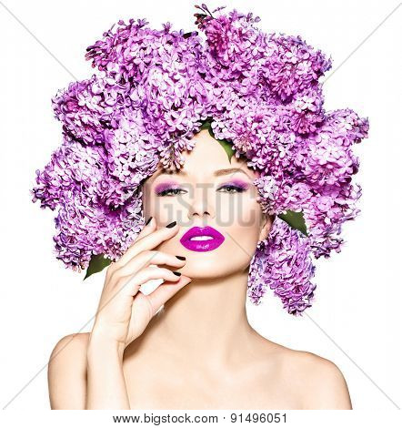 Beauty fashion model Girl with Lilac Flowers Hair Style. Beautiful Model woman with flowers on her head isolated on white background. Nature Hairstyle. Creative Makeup and manicure. Make up