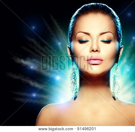 Fashion Glamour Model Woman portrait over black background. Earrings. Jewels. Trendy Makeup. Jewellery. Accessories. Perfect makeup