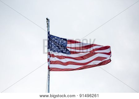 Flag Blowing Under Clouds