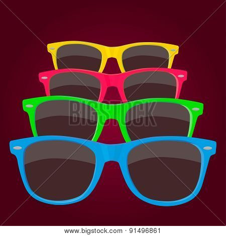 Colorful Sunglass On Maroon Background