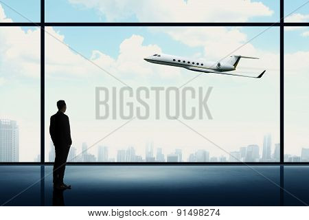 Man Looking On The Private Jet