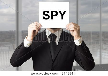 Businessman Hiding Face Behind Sign Spy