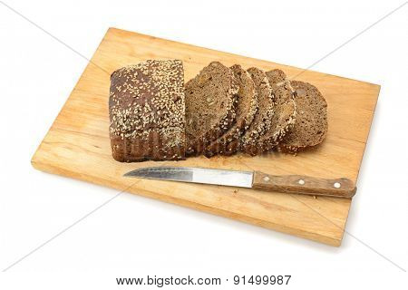 cut bread on breadboard isolated on white