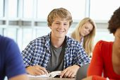 pic of 16 year old  - Teenage boy in class smiling to camera - JPG