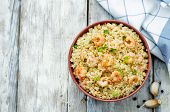 stock photo of quinoa  - quinoa with shrimp and parsley on a white wood background - JPG