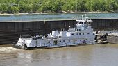 image of barge  - White Barge with No Markings or Insignia on a River with a Lock Wall - JPG