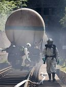 picture of decontamination  - A team working with toxic acids and chemicals is approaching a chemical cargo train crash near Sofia Bulgaria - JPG