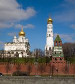 stock photo of fortified wall  - Kremlin embankment against the backdrop of the cathedral - JPG