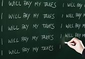 image of punishment  - I will pay my taxes sentence written repeatedly on blackboard as a punishment - JPG