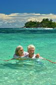 image of wallow  - Loving elderly couple bathing in the sea and looking at each other - JPG