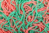 image of green snake  - red and green rubber candies in the shape of a snake with sugar - JPG