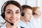 picture of helpdesk  - Three call center service operators at work - JPG