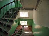 stock photo of high-rise  - The interior staircase between floors in high - JPG