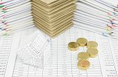 image of piles  - Bankruptcy of house and pile of gold coins as question mark on finance account have pile of envelope between paperwork as background.