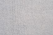 stock photo of knitting  - Light gray knitted fabric as background texture - JPG