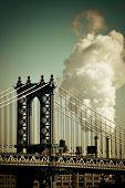 foto of chimney  - Manhattan Bridge with chimney smoke in New York City - JPG