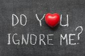 image of ignorant  - do you ignore me question handwritten on blackboard with heart symbol - JPG