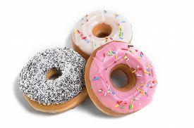 foto of addicted  - three delicious and tempting donuts with different flavor donuts and toppings isolated on white background in unhealthy nutrition and sugar and sweet cake addiction concept - JPG