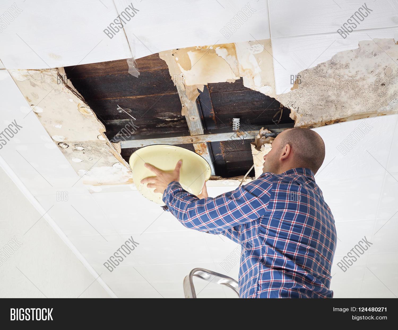 man collecting water basin g