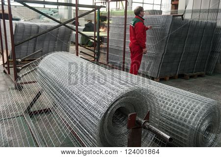 Leningrad, Russia - April 6, 2012: Plant for production of fences. Workshop packing wire mesh netting. Mesh netting in rolls