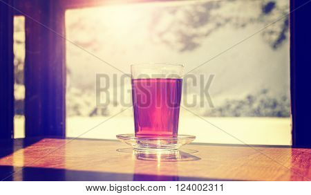 Vintage Stylized Glass Of Hot Tea On Wooden Table.