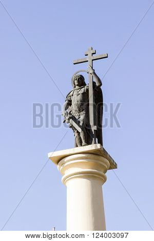 SOCHI RUSSIA - November 06 2015: The religious monument the defender Saint Michael the Archangel keeps a sword a cross in a fighting armor is established on Alexander Column. Sochi Russia