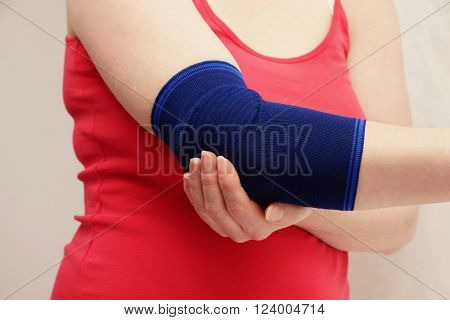 Woman hand with bandage against a white background