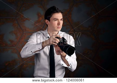 Photographer with camera in studio. moment after shot