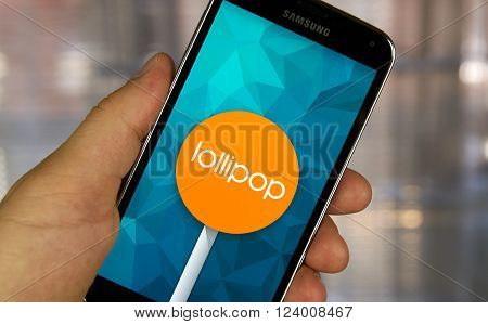 MONTREAL CANADA - MARCH 20 2016 - Android lollipop OS logo on smartphone. Android Lollipop is a version of the Android mobile operating system developed by Google