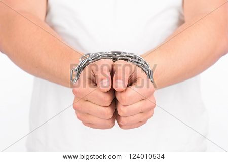 Hands with chain wrapped around them isolated on a white background
