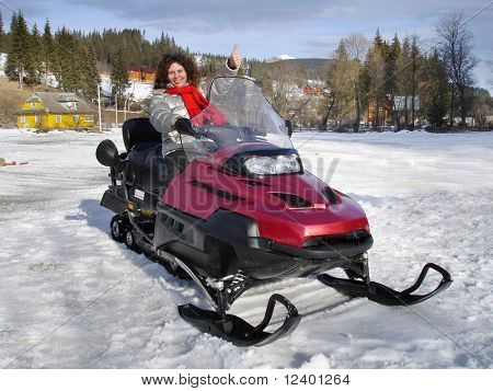 young woman on the snowmobile