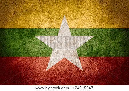 flag of Burma or Burmese banner on rough pattern background, Myanmar