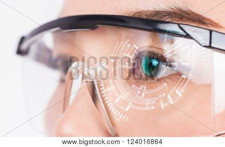 Close-up of woman's eye. High technologies in the futuristic.