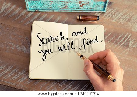 Retro effect and toned image of a woman hand writing on a notebook. Handwritten quote Search, and you will find as inspirational concept image