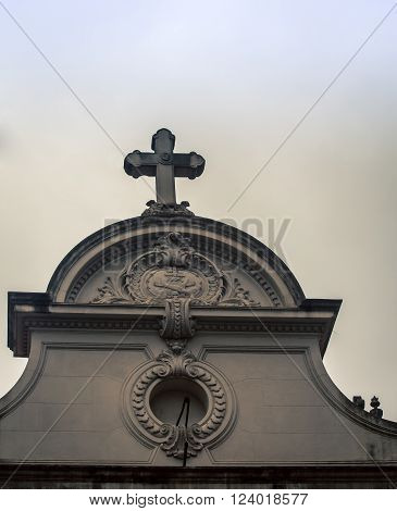 Ornate religious design with a cross on a cathedral