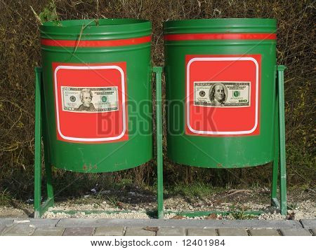 two dustbins with dollar labels - symbolic image