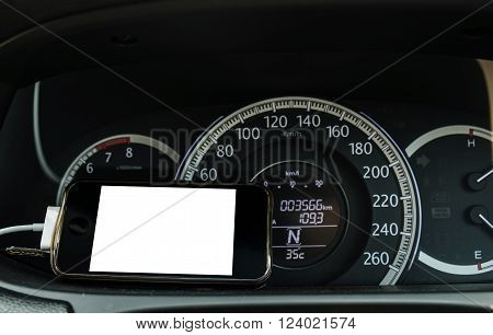 Smart phone with copy space on car front console, selective focus on phone