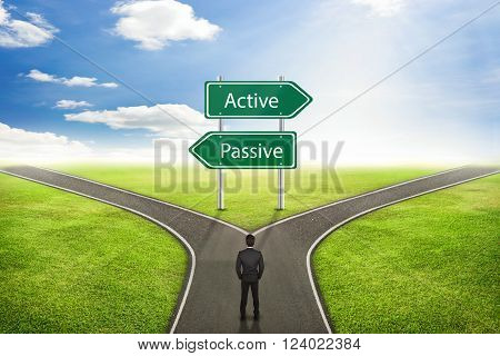 Businessman concept Sign Active or Passive road to the correct way.