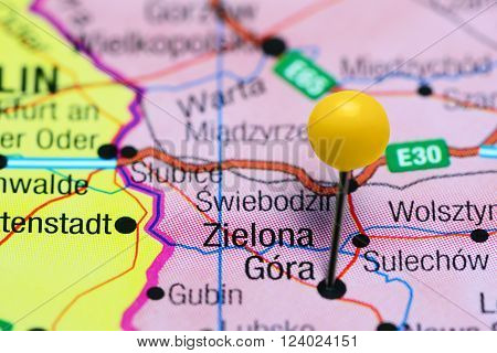 Photo of pinned Zielona Gora on a map of Poland. May be used as illustration for traveling theme.