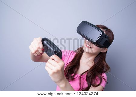 Happy woman playing games with the virtual reality headset Asian beauty