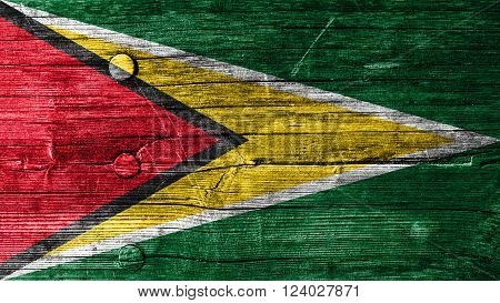 Flag of Guyana painted on wood texture