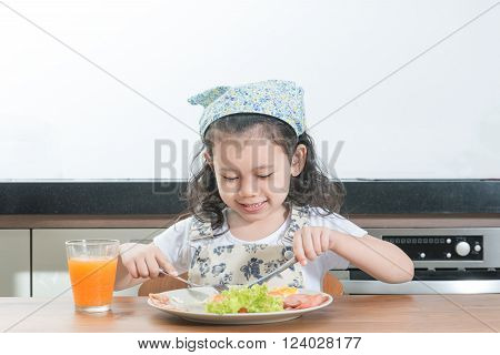family children and happy people concept - Asian girl child eating american breakfast in home
