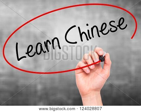 Man Hand Writing Learn Chinese With Black Marker On Visual Screen.
