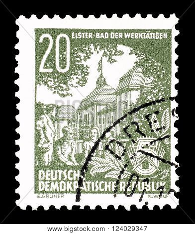 GERMAN DEMOCRATIC REPUBLIC - CIRCA 1954 : Cancelled postage stamp printed by German Democratic Republic, that shows people working.