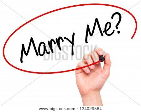 Man Hand Writing Marry Me? With Black Marker On Visual Screen.