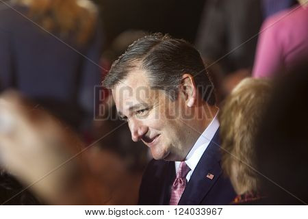 MADISON WI/USA - March 30 2016: Republican presidential candidate Ted Cruz listens to supporters during a free public forum on Women's issues in Madison Wisconsin on March 30 2016.