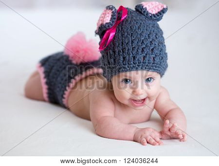 cute happy baby child in costume a rabbit bunny at home