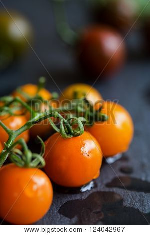 Varieties color of Cherry Tomatoes on stone board ** Note: Shallow depth of field