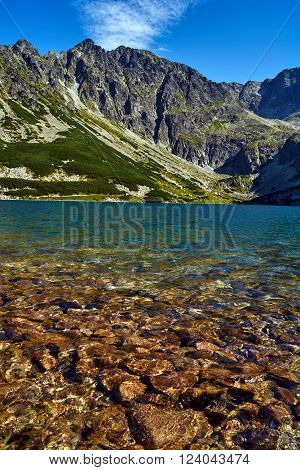 Lake and rocky peaks in the High Tatras mountains in Poland