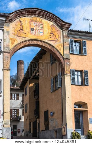 Corneliano,Alba,Piedmont,Italy : March 20, 2016 : View of the decagonal tower through the ancient entrance arch